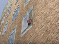 woman jumps off building
